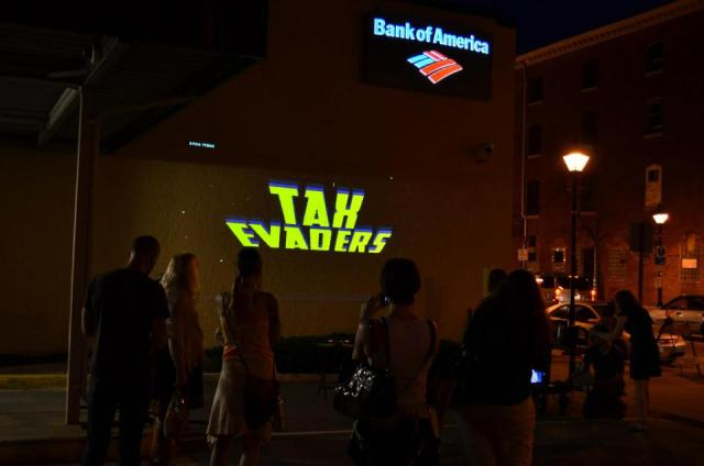 Activists from Luminous Intervention play Tax Evaders video game with a Kinects on a Bank of America building in downtown Baltimore Wednesday night.  http://luminousintervention.org/ Photo: Casey Mckeel